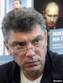 "Russian opposition leader Boris Nemtsov attends a news conference to present the report ""The Life of a Galley Slave"" in Moscow, August 28, 2012."