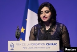 "FILE - Pakistan's Gulalai Ismail delivers an acceptance speech after being awarded the Prize for Conflict Prevention for the work of her organization ""Aware Girls"" promoting women's issues and equality in Pakistan, during the award ceremony of the Jacques Chirac Foundation at the Musee Branly in Paris, France, Nov. 24, 2016."