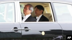 Japan's new Emperor Naruhito leaves the Imperial Palace, May 1, 2019, in Tokyo.