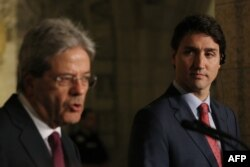 Canadian Prime Minister Justin Trudeau, right, and Prime Minister Paolo Gentiloni of Italy, hold a joint press conference in Ottawa, Ontario, April 21, 2017.