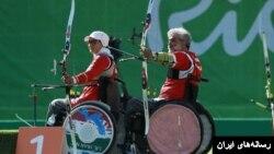 زهرا نعمتی در کنار ابراهیم رنجبر،از اعضای تیم تیراندازی ایران