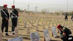 Kurdish soldiers stand in the graveyard for the victims of Halabja massacre. (File)