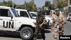 Thành viên của phái đoàn quan sát LHQ tại Syria trở lại khách sạn ở Damascus, ngày 20/8/2012