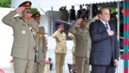 Prime Minister, Muhammad Nawaz Sharif and Chief of Army Staff, General Raheel Sharif saluting the National Flag,  at 129th PMA, 48th Integrated Course and 3rd Mujahid Course passing out parade held at Pakistan Military Academy Kakul on Saturday. Prime