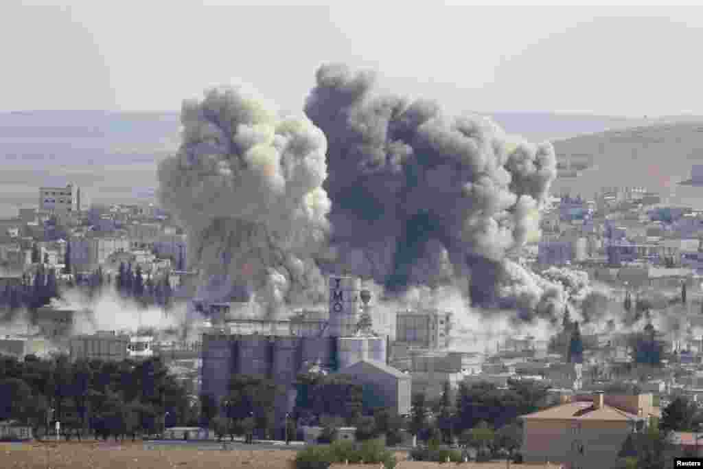 Smoke rises after a U.S.-led airstrike in the Syrian town of Kobani, Oct. 8, 2014.