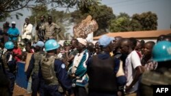 Residents of the PK5 district rally in front of the MINUSCA, the United Nations mission in Central African Republic's headquarters, calling for more security measures during a constitutional referendum, in the flashpoint enclave in Bangui, on Dec. 13, 2015.