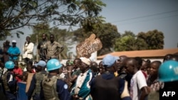 Demonstrators in front of MINUSCA, the UN mission in CAR, call for more polling station security ahead of constitutional referendum, Bangui, Dec. 13, 2015.