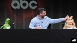 """Kermit the Frog, writer/executive producer Bob Kushell and Miss Piggy participate in a panel presentation for """"The Muppets"""" at the Disney/ABC Summer TCA Tour at the Beverly Hilton Hotel in Beverly Hills, Calif., Aug. 4, 2015."""