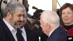 اکتوبر 19، 2010، سابق امریکی صدر جمی کارٹر حماس کے رہنما خالد مشعل کے ساتھ دمشق میں ملاقات کرتے ہوئے۔