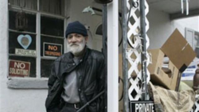 Charles O'Bryan outside his home in Cincinnati, Ohio, in November 2008. He faced criminal action for hoarding-related health code violations, but said he was a collector who often fixed things to give away or sell.