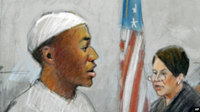 In a courtroom sketch, Umar Farouk Abdulmutallab is sentenced to life in prison by U.S. District Judge Nancy Edmonds in federal court in Detroit, Feb. 16, 2012.