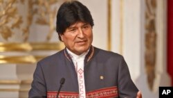 Bolivia's President Evo Morales gestures as he speaks to the media during a joint media conference with France's President Francois Hollande at the Elysee Palace in Paris, France, Nov. 9, 2015.