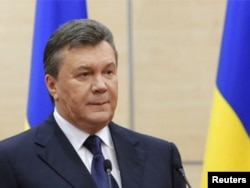 FILE - Ousted Ukrainian President Viktor Yanukovich makes a statement during a news conference in the southern Russian city of Rostov-on-Don, March 11, 2014.