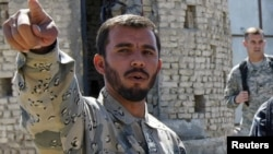 جنرال رازق و قوماندان قول اردوی ۲۰۵ اتل امروز به ولسوالی نیش رفته بودند