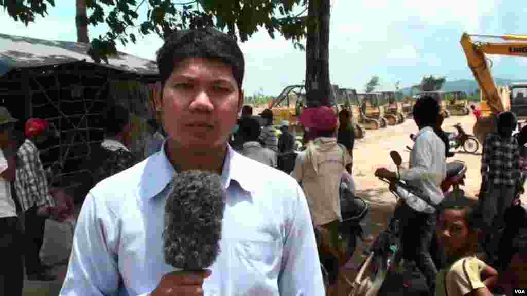 Reporter Mony Say at a land eviction dispute.
