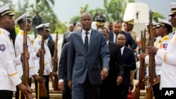 In this April 7, 2018, file photo, Haiti's President Jovenel Moise, center, leaves the museum during a ceremony marking the 215th anniversary of revolutionary hero Toussaint Louverture's death, at the National Pantheon museum in Port-au-Prince, Haiti. (AP Photo/Dieu Nalio Chery)