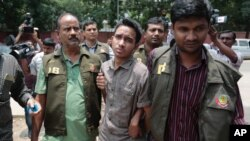 Members of Bangladesh Police Detective Branch escort Sumon Hossain Patwari in Dhaka, Bangladesh, Thursday, June 16, 2016.