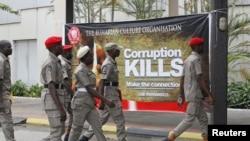 """Security personnel arrive at the first annual summit of the newly launched anti-corruption group """"Buharian Culture Organization"""" in Abuja, Nigeria."""