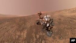 This composite image made from a series of Jan. 23, 2018 photos shows a self-portrait of NASA's Curiosity Mars rover on Vera Rubin Ridge. (NASA/JPL-Caltech/MSSS via AP)