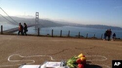 A chalk outline of a body is seen near the Golden Gate bridge in San Francisco.