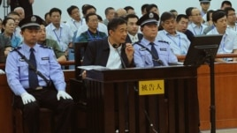 Former Politburo member and party leader of Chongqing, Bo Xilai, sits in the defendant seat and listens Wang Lijun's testimony, Aug. 24, 2013.