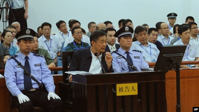 In this photo released by the Jinan Intermediate People's Court, Bo Xilai listens to a testimony by former Chongqing city police chief Wang Lijun, unseen, at Jinan Intermediate People's Court in Jinan in eastern China's Shandong province, Aug. 24, 2013.