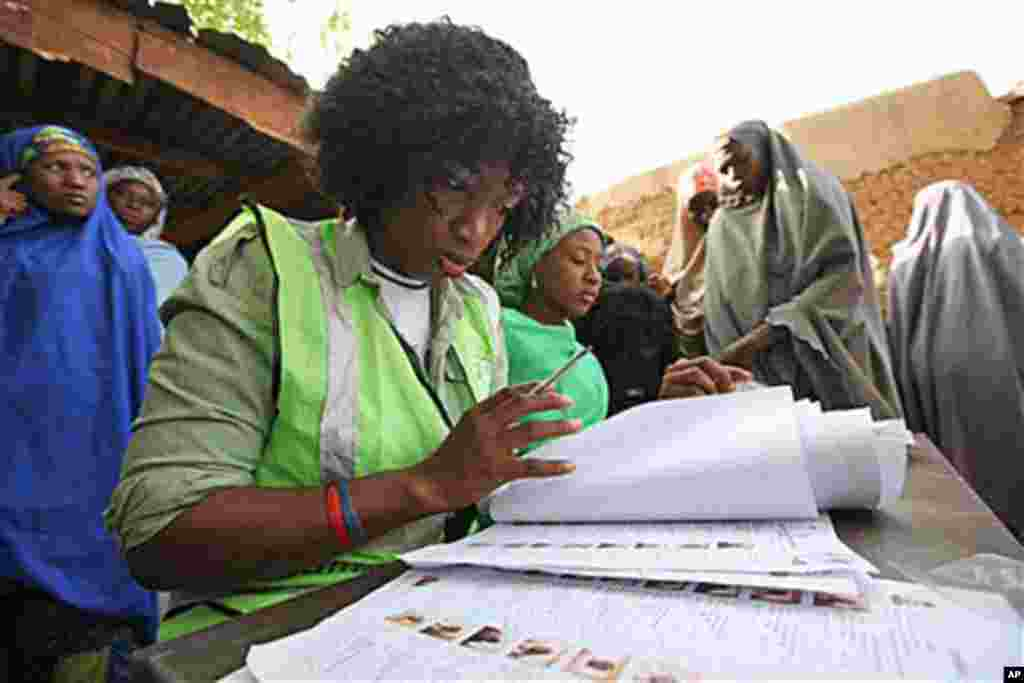 An electoral official check a voters name at a polling place in Daura, Nigeria, Saturday, April 16, 2011. (AP image)