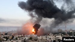 Smoke and flames rise during Israeli air strikes amid a flare-up of Israeli-Palestinian violence, in Gaza May 12, 2021. (REUTERS/Ibraheem Abu Mustafa)
