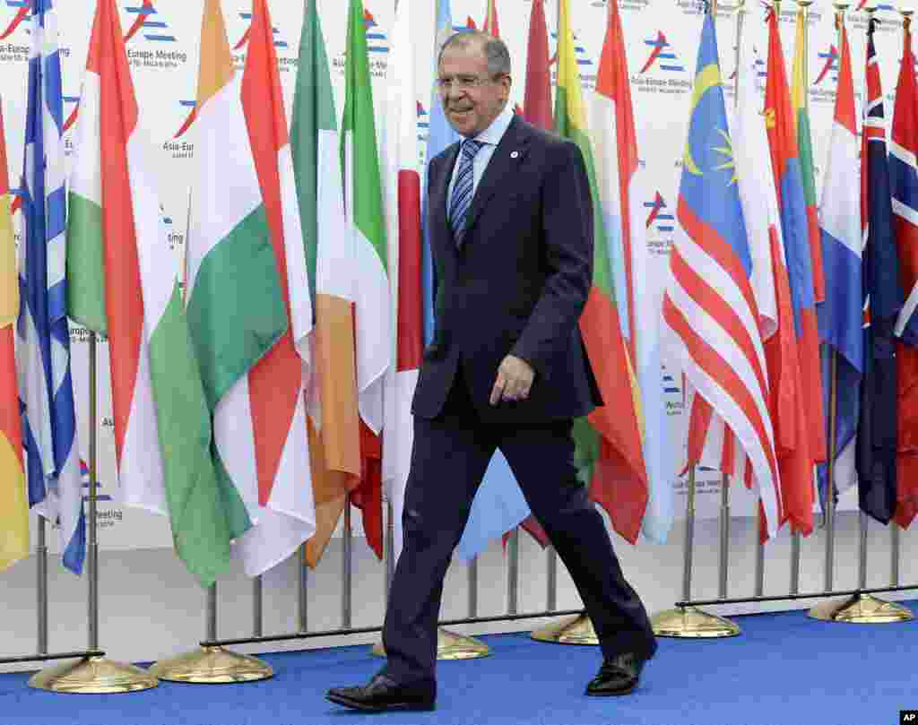 Russian Foreign Minister Sergej Lavrov arrives at the 10th Asia-Europe Meeting (ASEM) while Russian President Vladimir Putin (unseen) is mounting a diplomatic blitz on the sidelines of the summit, in Milan, Italy, Oct. 16, 2014.