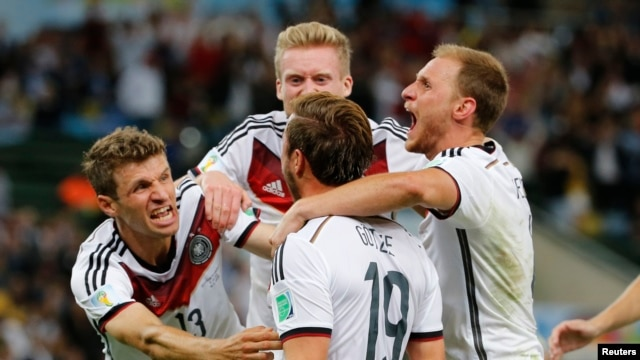 Germany's Mario Goetze (C) celebrates with teammates after scoring against Argentina during extra time in their 2014 World Cup final at the Maracana stadium in Rio de Janeiro July 13, 2014.