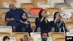 Female supporters of Al-Ahli get the chance to cheer on their team from inside a formerly men-only stadium in Jeddah for the first time. (AFP)