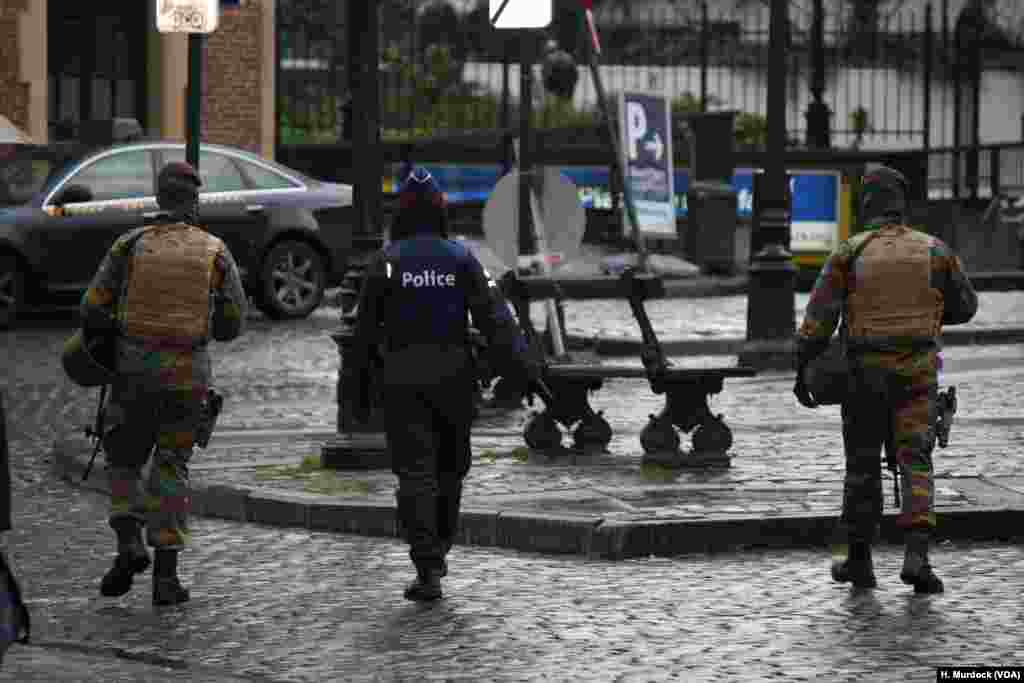 Security forces appear generally calm as they widen their search for men suspected of being involved in the Paris attacks, and possibly planning attacks in Brussels, Belgium.