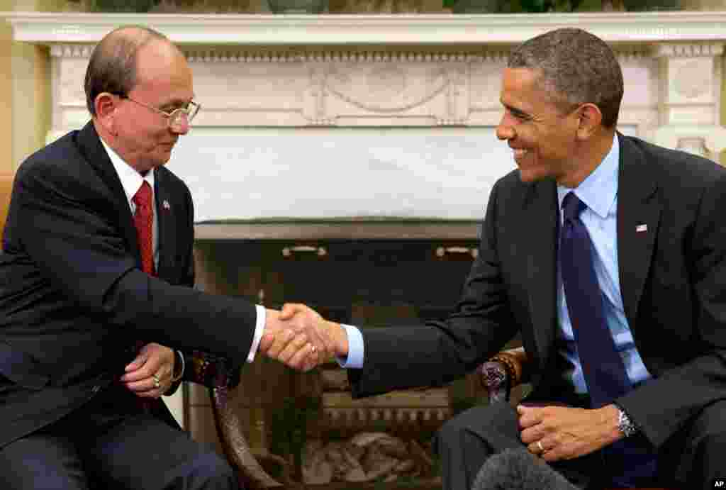 President Barack Obama shakes hands with Burma's President Thein Sein at their meeting in the Oval Office of the White House in Washington, May 20, 2013. Thein Sein is the first Burmese president to be welcomed to the White House in almost 47 years.
