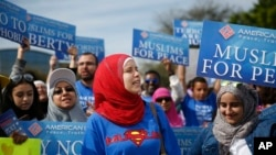 """FILE -- Protesters stand across the street from a Donald Trump rally holding """"Muslims for Peace"""" signs before a campaign rally in Orlando, Florida"""