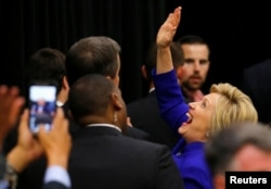 FILE - U.S. Democratic presidential candidate Hillary Clinton waves to supporters in the crowd during a campaign stop in Long Beach, California, June 6, 2016.