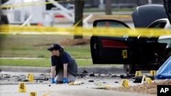 An FBI crime scene investigator documents the area of last week's attack in Garland, Texas, May 4, 2015.