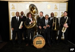 The Preservation Hall Jazz Band poses in the press room at the 58th annual Grammy Awards in Los Angeles, on Feb. 15, 2016.