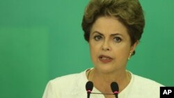 Brazil's President Dilma Rousseff speaks during a press conference after impeachment proceedings were opened against her by the President of Chamber of Deputies Eduardo Cunha.