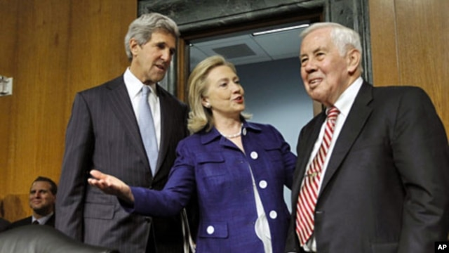 Secretary of State Hillary Clinton talks with Senate Foreign Relations Committee Chairman Sen. John Kerry (L), and the committee's ranking Republican, Sen. Richard Lugar on Capitol Hill, June 23, 2011, prior to testifying on U.S. policies in Afghanistan a