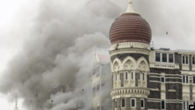 In this Saturday, Nov. 29, 2008 file picture, smoke billows from the landmark Taj Mahal hotel in Mumbai, India after an attack by gunmen