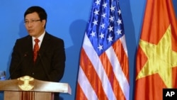 FILE - Vietnamese Foreign Minister Pham Binh Minh speaks during a joint press conference with U.S. Secretary of State John Kerry in Hanoi, Dec. 16, 2013.