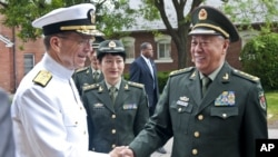 Navy Adm. Mike Mullen, Chairman of the Joint Chiefs of Staff, greets General Chen Bingde, Chief of the General Staff, People's Liberation Army, People's Republic of China at Comny Hall Joint Base Myer-Henderson Hall on May 17, 2011.