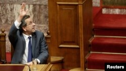 Greece's Prime Minister Antonis Samaras votes during a parliament vote on a series of reforms, in Athens, July 18, 2013.