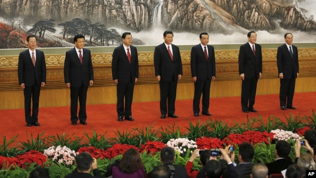 New members of the Politburo Standing Committee, from left, Zhang Gaoli, Liu Yunshan, Zhang Dejiang, Xi Jinping, Li Keqiang, Yu Zhengsheng and Wang Qishan stand in Beijing's Great Hall of the People, November 15, 2012.