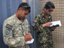 Sergeant First Class David Lara, left, is putting Afghan Air Force flight medics through their paces as he works with Afghan Air Force Sergeant Hayatullah Bahar, Aug 2010
