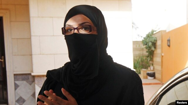 A female Saudi motorist speaks to the media after driving her vehicle in defiance of the ban on driving in Riyadh June 22, 2011.