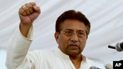 FILE - Pakistan's former President and military ruler Pervez Musharraf addresses his party supporters at his house in Islamabad.