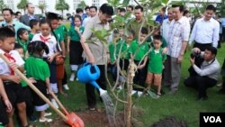 FILE: Lao Prime minister Thongloun Sisoulith plant a tree to commemorate Children Day in 2017