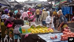 People buy food at a local market in Monrovia, Liberia. The area had been closed off in August because of the Ebola outbreak.
