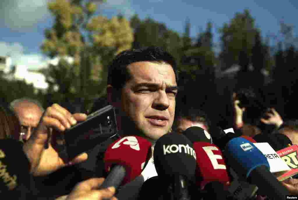 Alexis Tsipras, opposition leader and head of radical leftist Syriza party, talks to reporters outside the parliament building after the last round of presidential voting, Athens, Dec. 29, 2014.